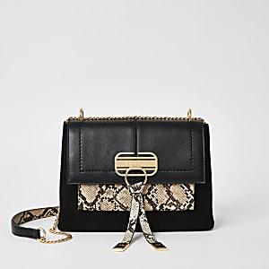 Zwarte crossbodytas met slangenprint en slotje voor