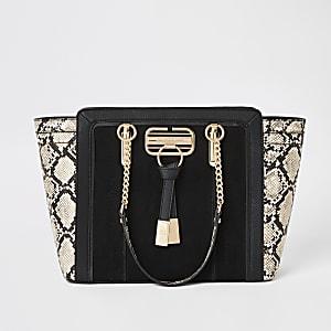 Zwarte handtas met zij-inzetten en slangenprint