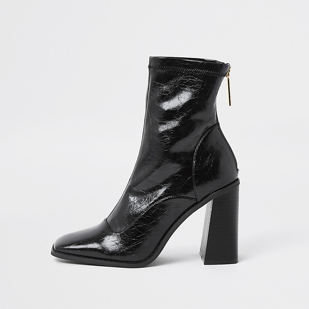 Black sock heel boot