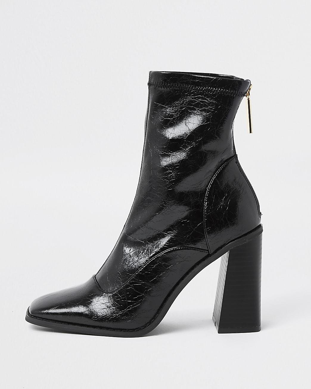 Black sock heel boots
