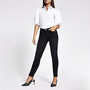 Amelie - Zwarte mid rise skinny jeans met gespleten zoom