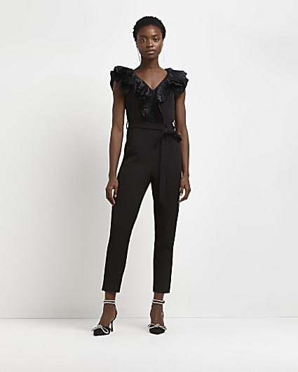 Black spot frill detail tie back jumpsuit