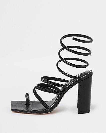 Black strappy heeled sandals