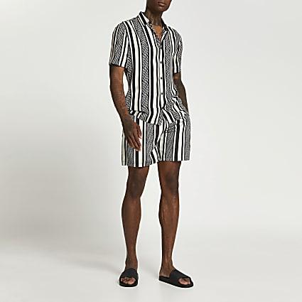 Black stripe elasticated waist swim shorts