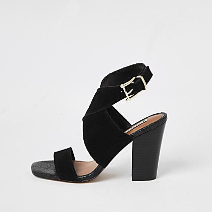 Black suede cross strap heeled shoe boots
