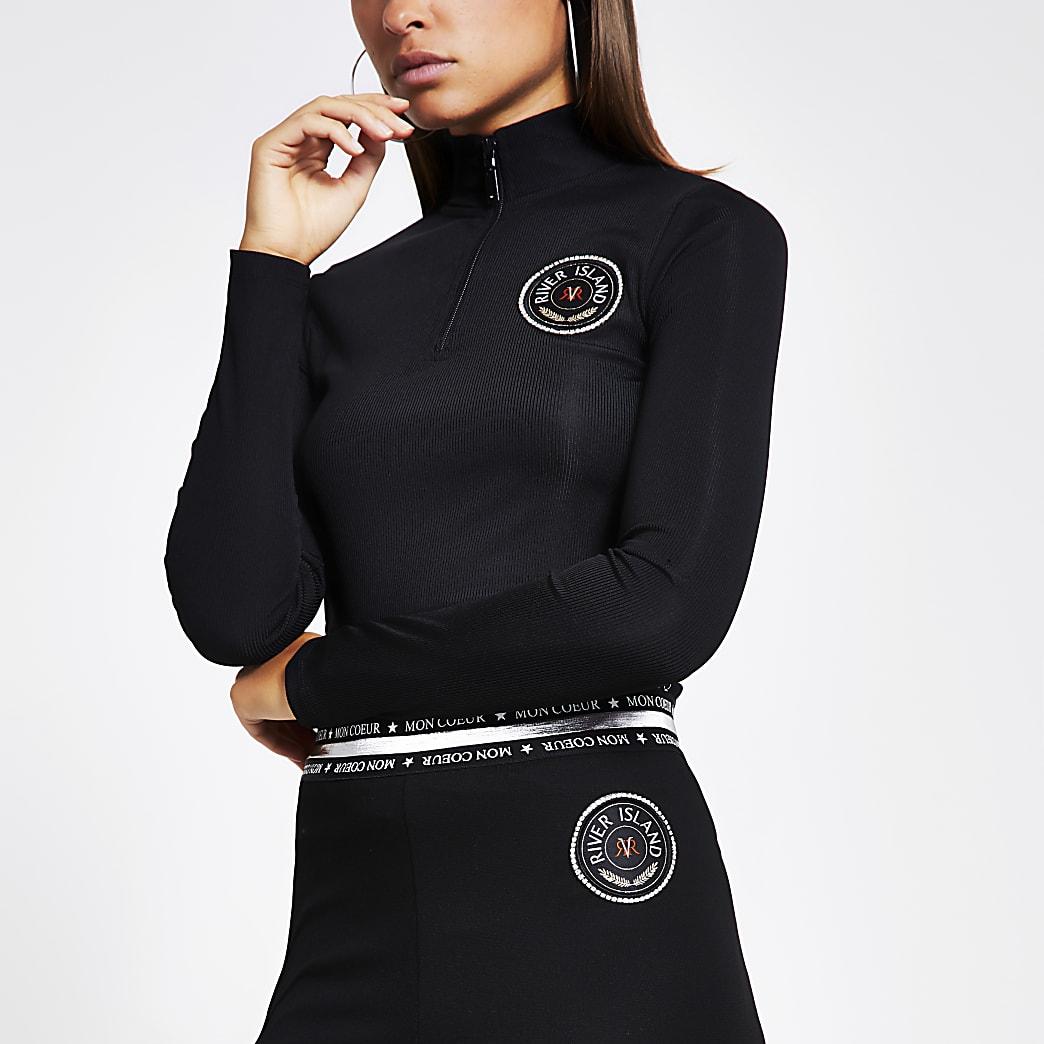 Top côtelé noir avec bande latérale et col zippé