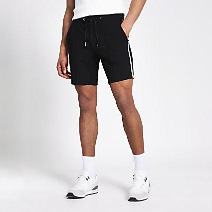 Black tape side Sid skinny fit shorts