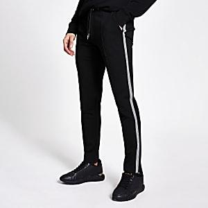Elegante Slim Fit Jogginghose in Schwarz mit seitlichem Tape