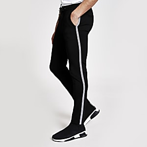 Elegante Super Skinny Fit Jogginghose in Schwarz mit seitlichem Tape