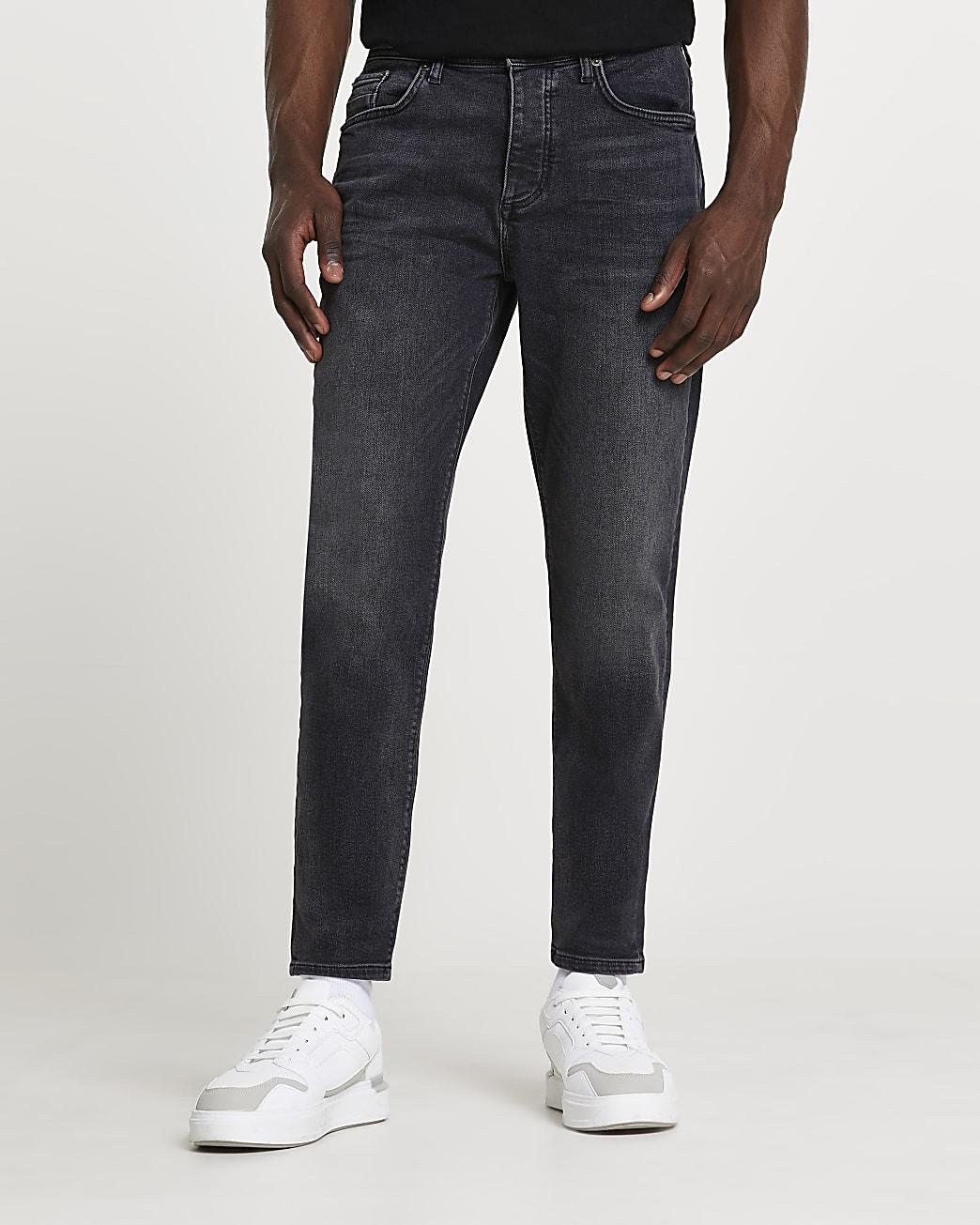 Black tapered denim jeans