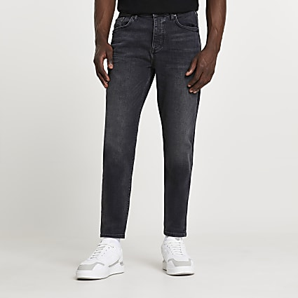 Black tapered denim jeans