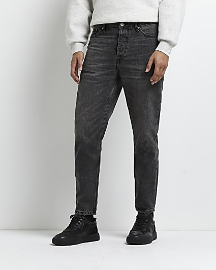 Black tapered fit ripped jeans