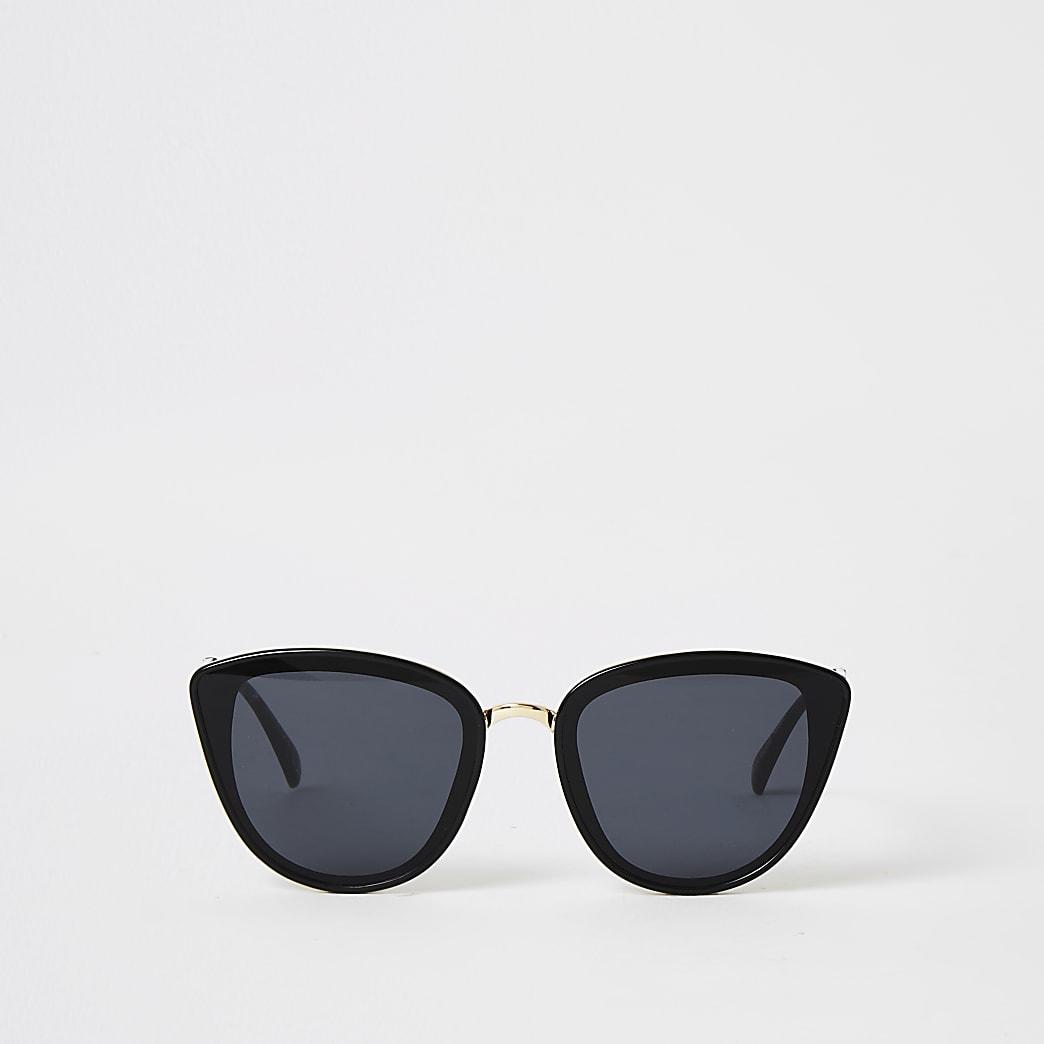Schwarze Sonnenbrillen im Katzenaugen-Stil mit strukturiertem Bügel