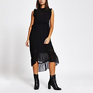 Zwarte gesmokte midi-jurk met textuur en ruche