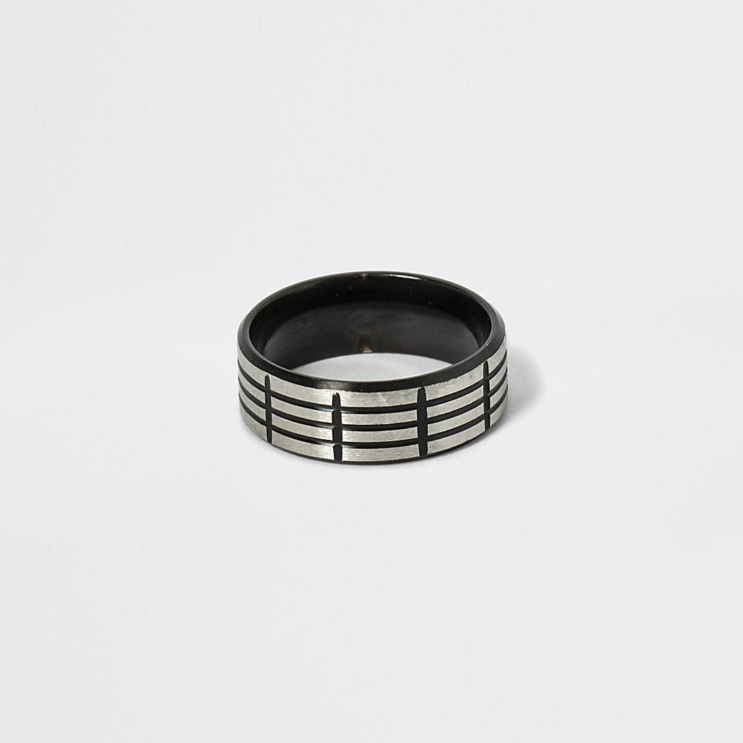 Zwarte stalen ring met textuur