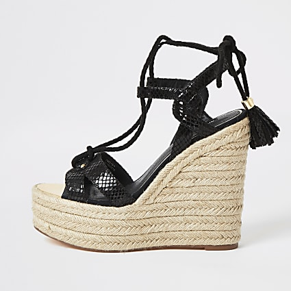 Black tie ankle high wedge sandals