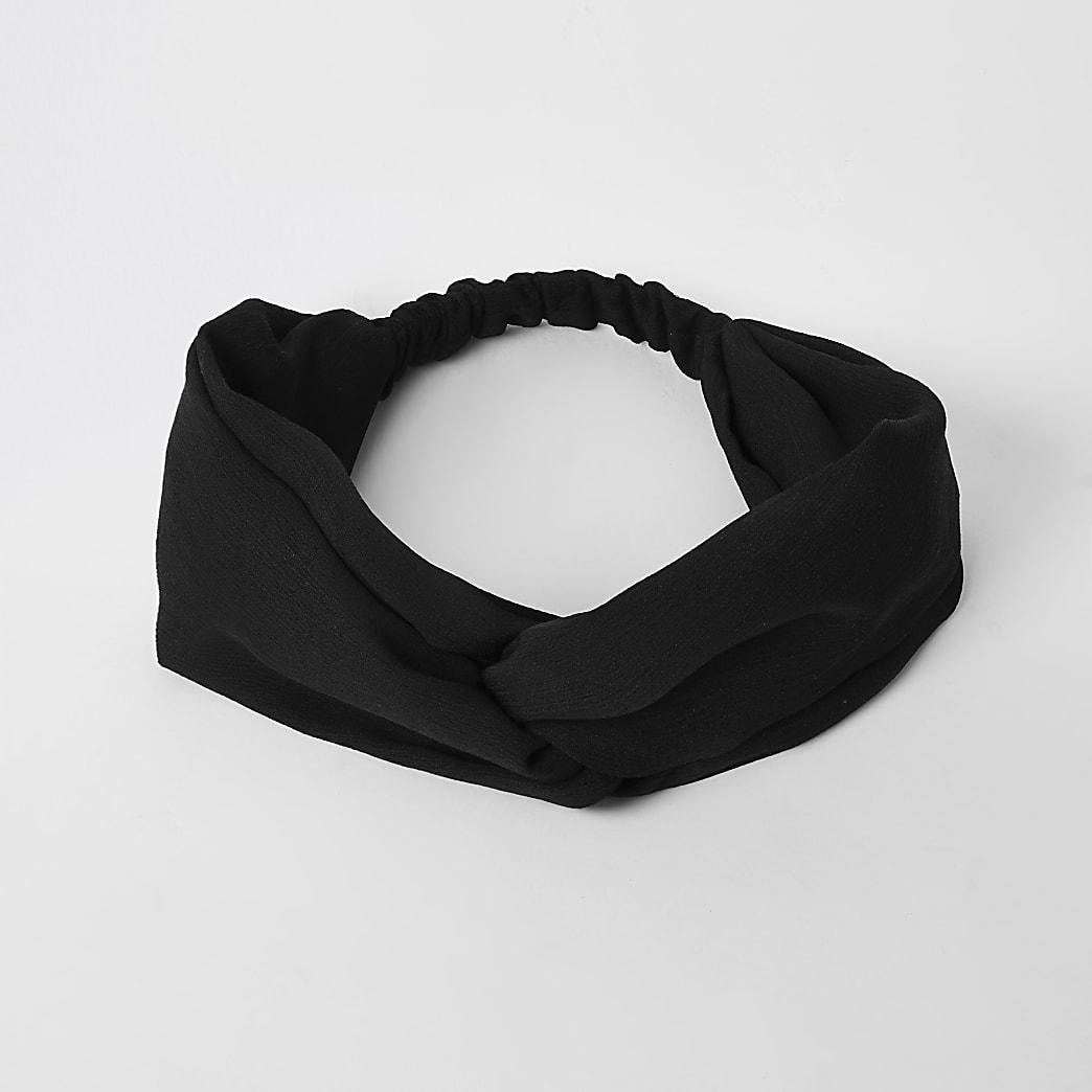 Schwarzes Haarband mit verdrehter Vorderseite