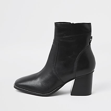 Black unlined faux leather block heel boot