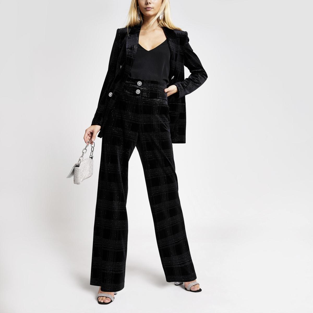 Zwarte fluwelen geruite uitlopende broek met glitters