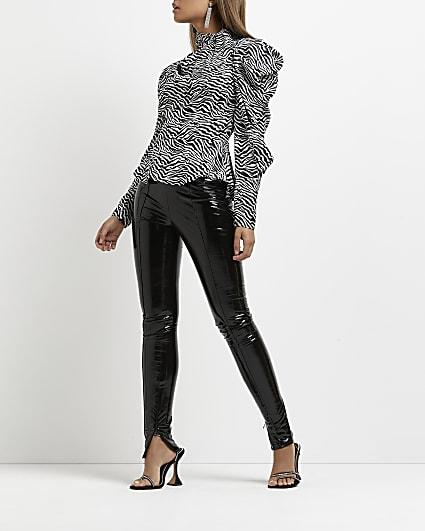 Black vinyl skinny trousers