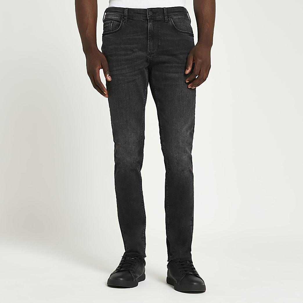 Black washed raw hem skinny fit jeans