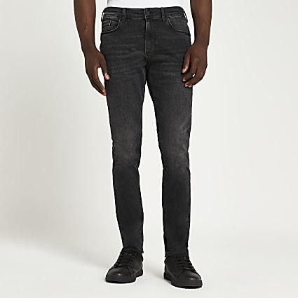 Black washed raw hem skinny jeans
