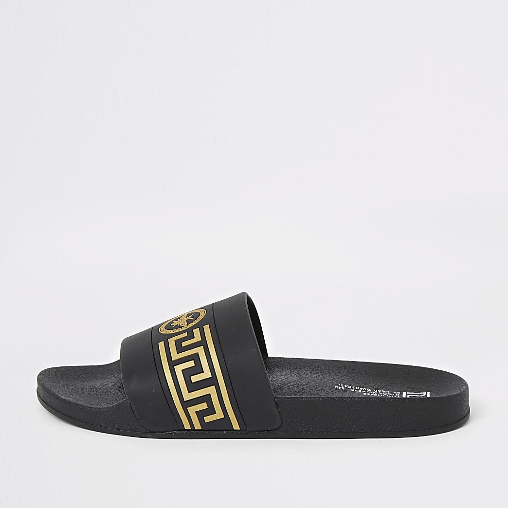 Zwarte slippers met wespenprint