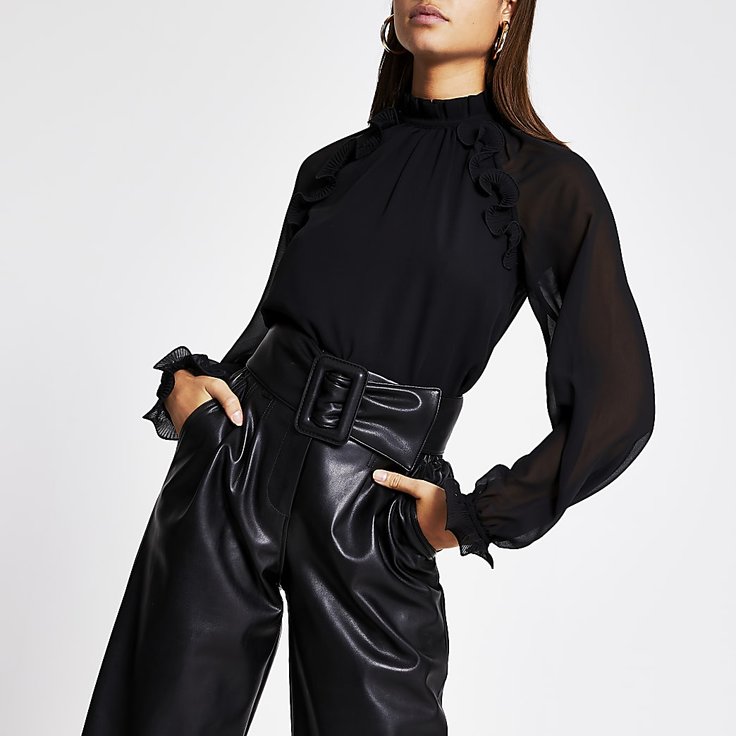 Zwarte doorschijnende blouse met ruches en lange mouwen
