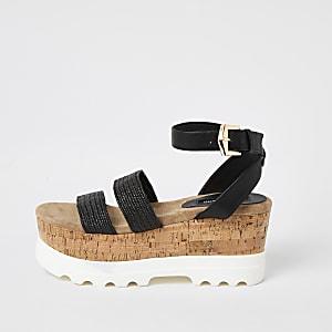 Schwarze Sandalen mit gewebten Riemen und Keilabsatz