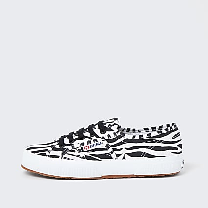 Black zebra lace up trainers