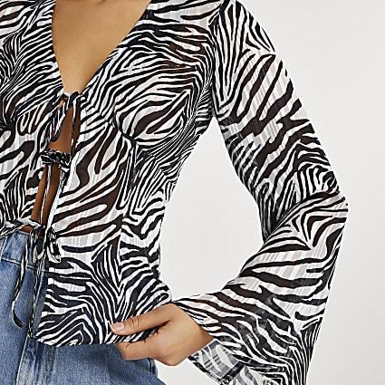 Black zebra print tie front blouse
