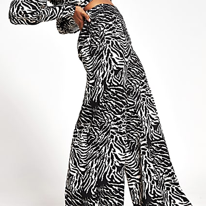 Black zebra print wide leg trousers