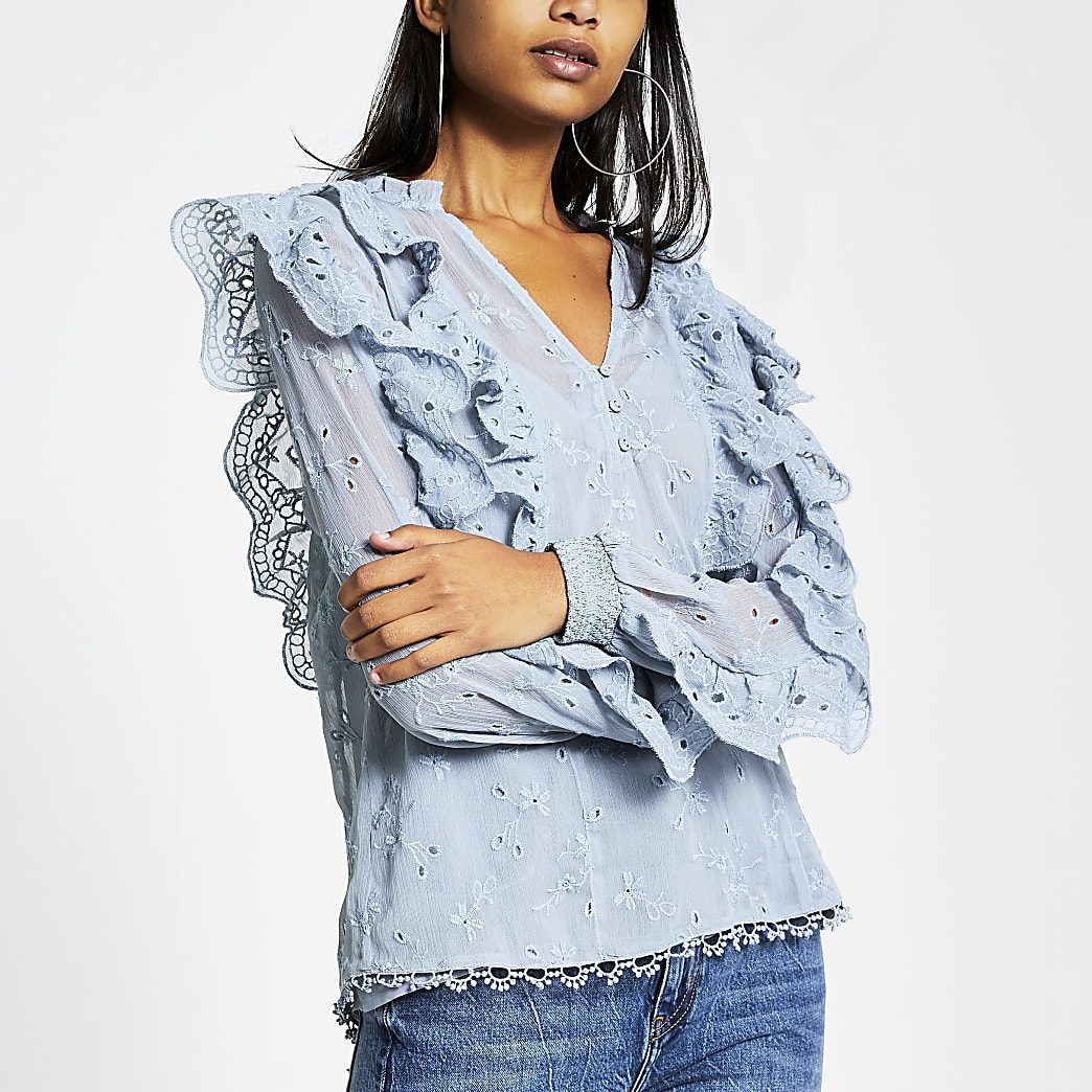 Blue broderie frill long sleeve blouse
