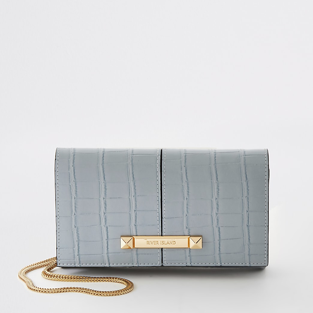 Blue croc embossed underarm clutch bag