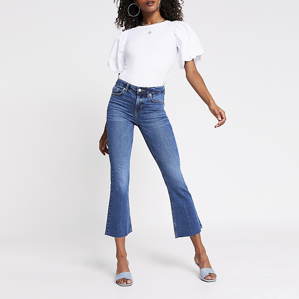 Blue denim mid rise kick flare jeans