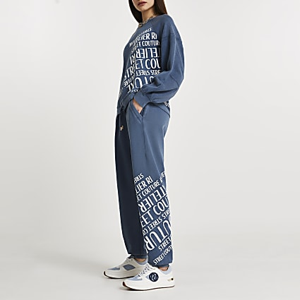 Blue denim RI slogan print cuffed joggers