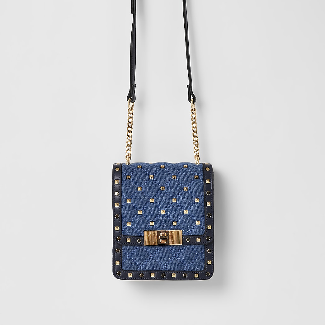 Blauwe denim crossbodytas met studs