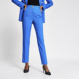 Blauwe smaltoelopende broek met dubbele knopen