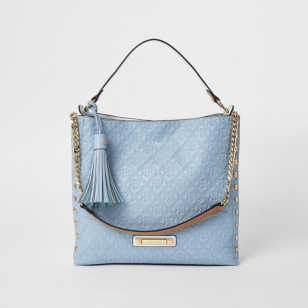 Blue embossed slouch Handbag
