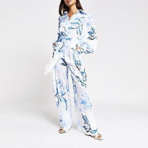 Pantalon bleu à fleur, ceinture et pattes d'éléphant