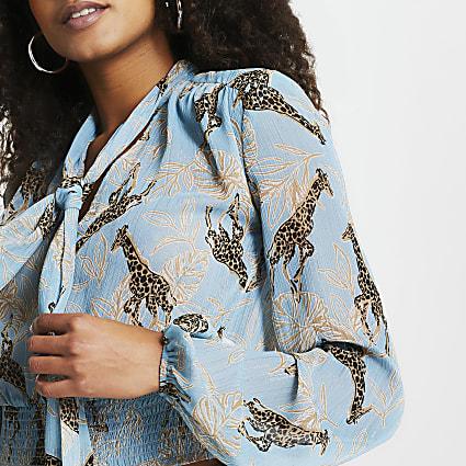 Blue giraffe print tie neck crop blouse top