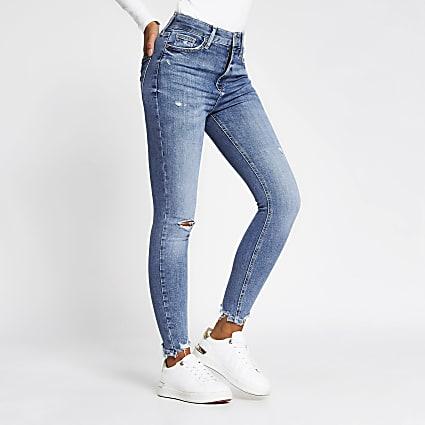 Blue high rise super skinny rip detail jeans