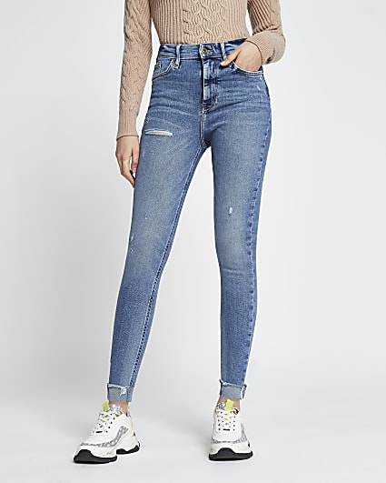 Blue high waisted skinny ripped turn up jeans