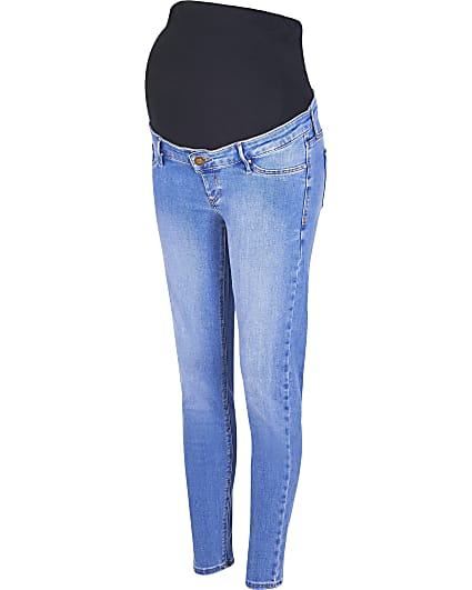 Blue mid rise maternity skinny jeans