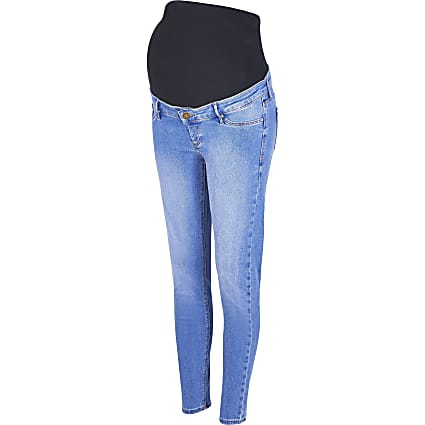 Blue mid rise skinny maternity jeans