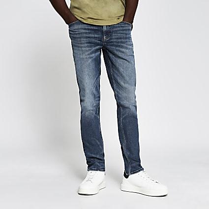 Blue mid wash Sid skinny jeans