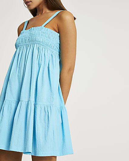 Blue mini shirred parachute dress