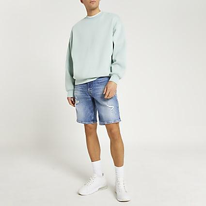 Blue oversized denim shorts