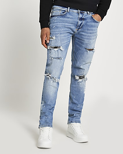Blue paint splat relaxed skinny fit jeans