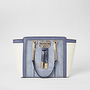 Blauwe handtas met panelen